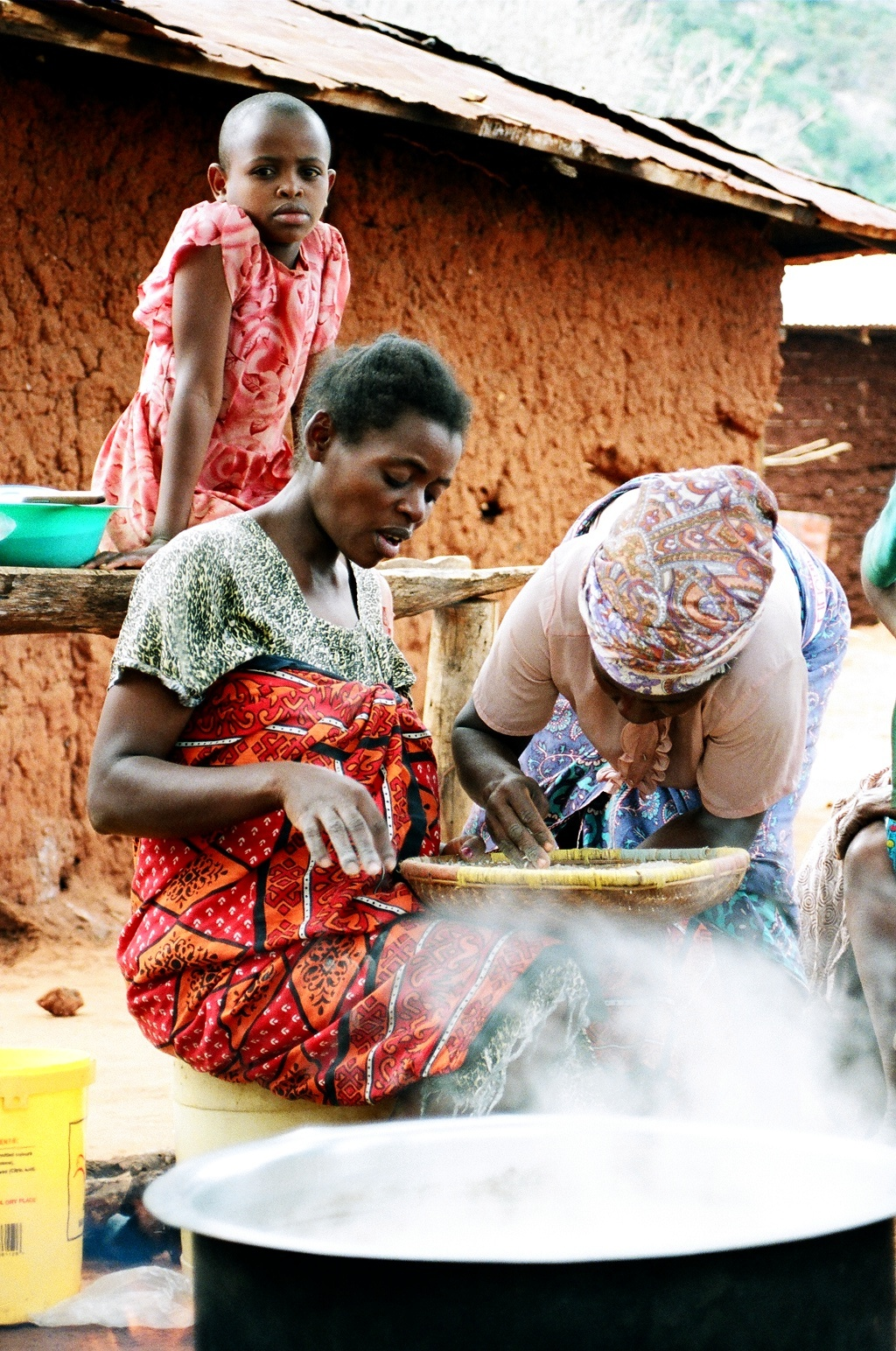 locals cooking when you travel in Africa