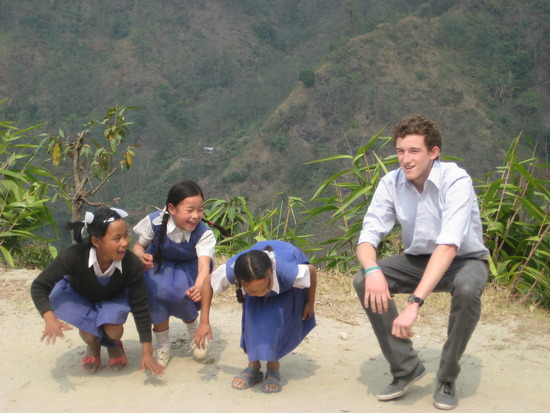 Playing with the children in the community on your Gap Year with friends