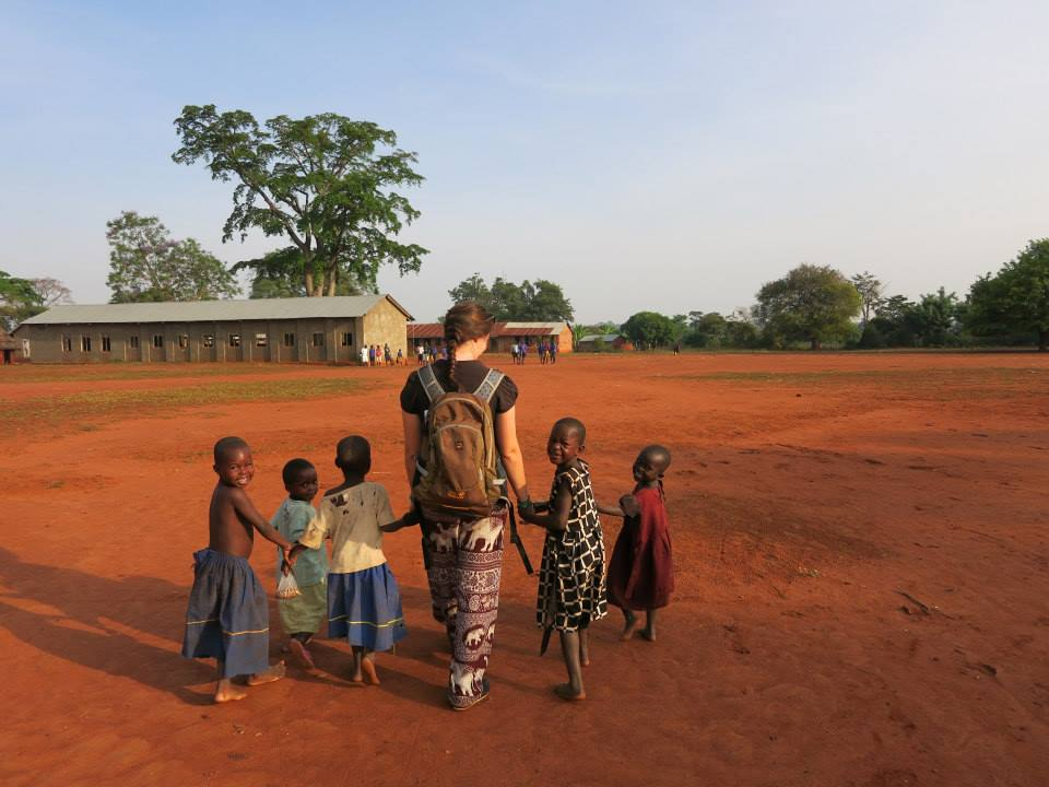 Unexpected exam results could help you make a difference, walking to school with children in Uganda on a Gap Year